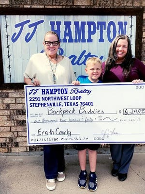 Pictured from left, JJ Hampton, Kason's mom and local real estate agent; Kason Prince; and Julie Howell, president of Backpack Buddies of Erath County.