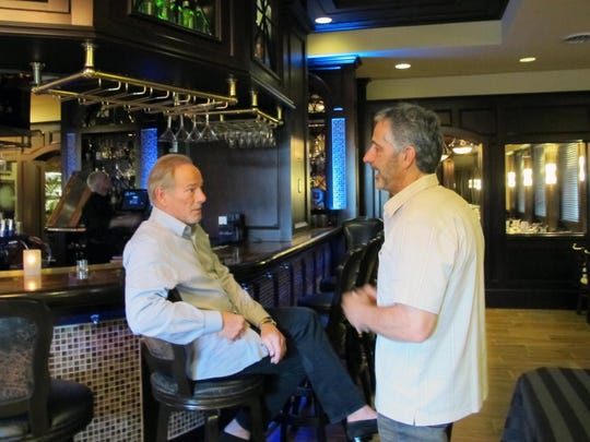Bob Germain Jr., left, chats with Matt Berman on Tuesday at the newly opened St. Germain Steakhouse in Naples.