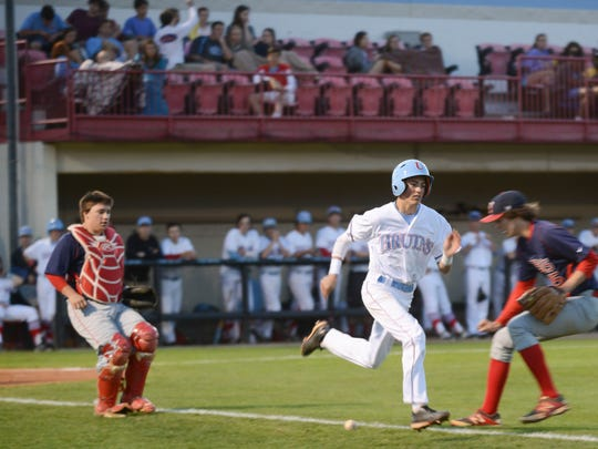 USJ's Jake Overton runs past Tipton-Rosemark's pitcher and catcher Tuesday evening while running to first base.