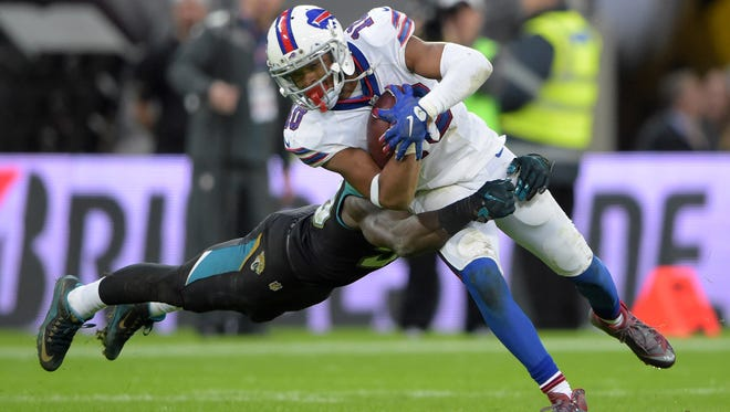 Buffalo Bills receiver Robert Woods is tackled by Jacksonville linebacker Telvin Smith during the Bills' 34-31 loss in London on Sunday. The game was the first in NFL history to be livestreamed to a worldwide audience.