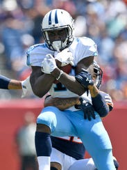 Titans wide receiver Taywan Taylor (13) gets stopped