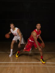 Maryland basketball players Melo Trimble, right,  and