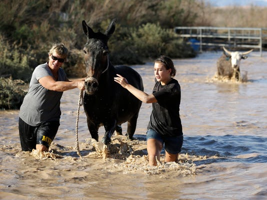 AP APTOPIX Southwest Flooding