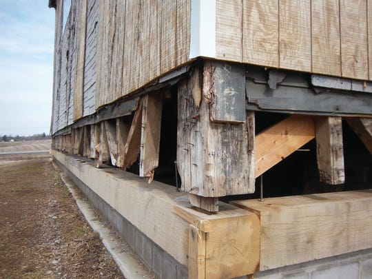 Original timbers from the 1816 construction have been preserved and will fit into new construction during the restoration. About 80 percent of the original structure remains, although in pieces that need reassembly.