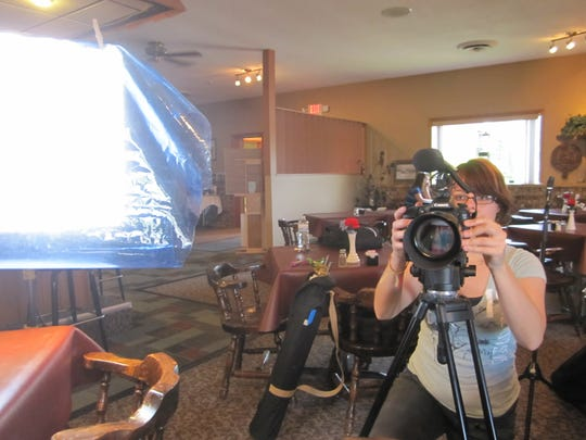 "Camera person Amanda Clifford sets up a shot for Holly De Ruyter's documentary, ""Old Fashioned: The Story of the Wisconsin Supper Club."""
