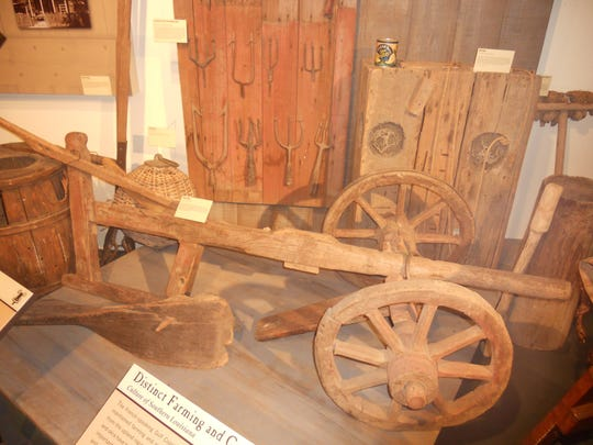A wheeled plow, like those used on Acadian farms in