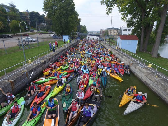 Peyton Brandt uses his drone to photograph kayakers in Appleton Lock 3.