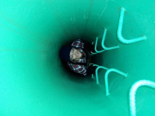 """Maggie Lanham in the """"Observation Tube,"""" which is inserted into the sea ice to take a look at sea creatures. Lanham enjoys looking for seals who she says love to swim under the ice."""