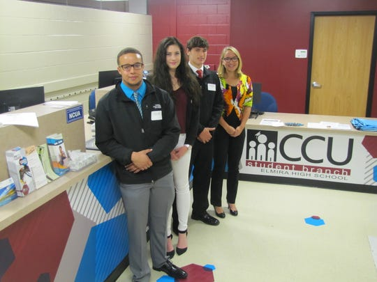 Nine Elmira High School students will work as interns in the new student branch there of Corning Credit Union. From left: Anthony Knight, Sam Holleran, Mike Stearns and Alexis Wheeler.