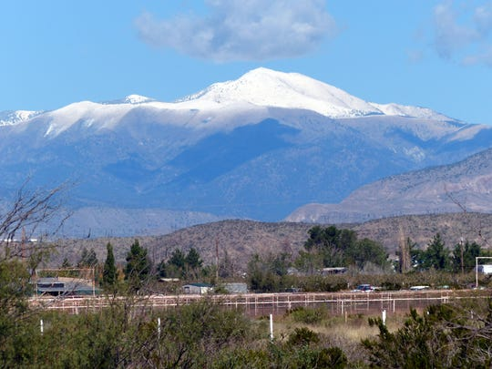 Viewed from horse ranches near  Tularosa, Sierra Blanca Peak and the surrounding Sacramento Mountains were coated with snow after a storm hit Ruidoso.