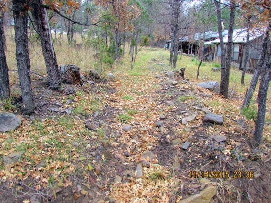 A depression is all that's left of the Wingfield Ditch in back a former village official's family home in Ruidoso.