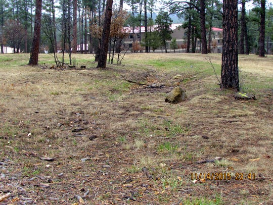 The old ditch is visible near Hotel Ruidoso in the