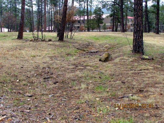 The old ditch is visible near Hotel Ruidoso in the background.