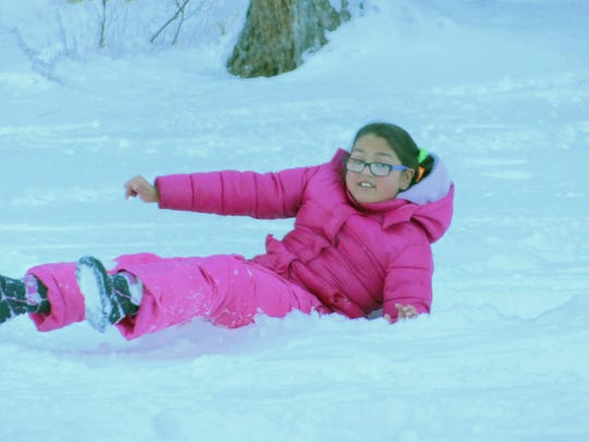 A sledder enjoys the snow at a favorite spot in Ruidoso