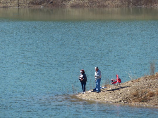 A couple enjoy a sunny day at Grindstone fishing for trout.