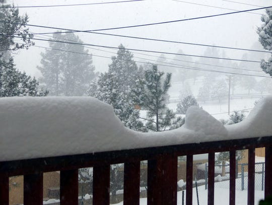 Snow topped 14 inches midday Sunday in Ruidoso and