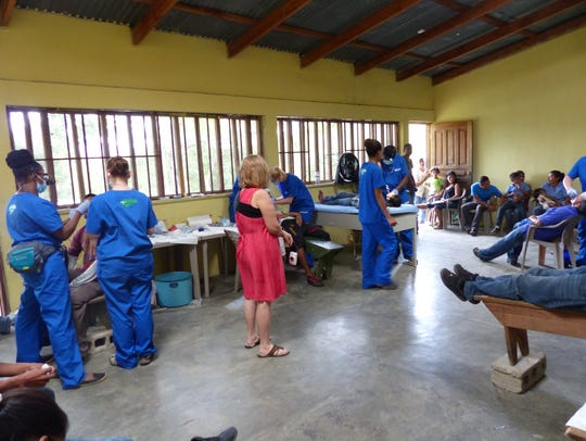 Dentists help patients during a mission trip.