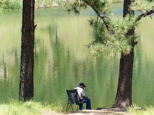 A fisherman enjoys Alto Lake on a weekday afternoon.