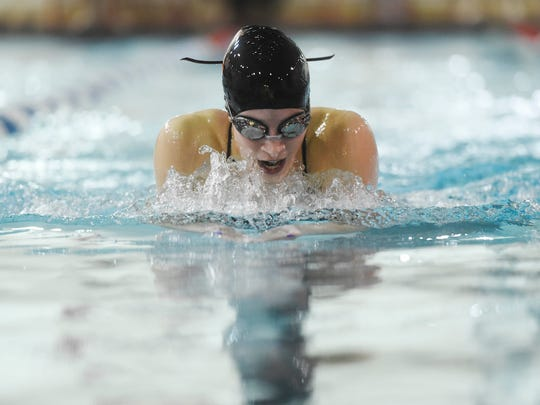 York Suburban's Keelie Walker takes first in the girls' 100-yard breaststroke during Thursday's swim meet at Dover. York Suburban swept the meet winning both the girls and boys meet. Walker also swam on the Trojans' winning 200 medley and 200 freestyle relays to help Suburban earn a 100-83 victory. The Suburban boys' team also won and secured at least a share of the YAIAA Division II title.