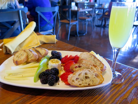 The Fruit & Cheese Plate appetizer features a variety