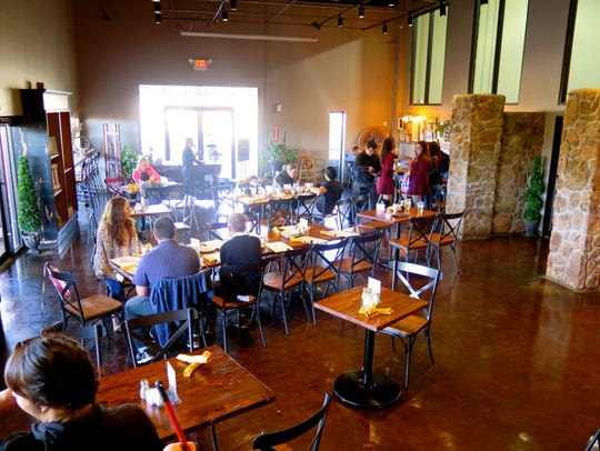 The dining room is open and bright, with natural light