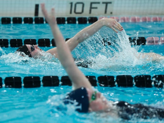 York Suburban's Carson Gross, top, begins to pull ahead of West York's Taylor Hoover in the girls' 200-yard IM during a February meet. Gross won and Hoover placed second.