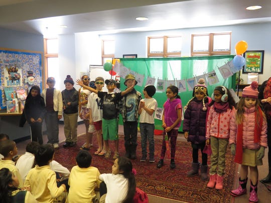 Third grade students at The Wardlaw-Hartridge School in Edison model attire reflecting the four seasons during a Spanish Fashion Show