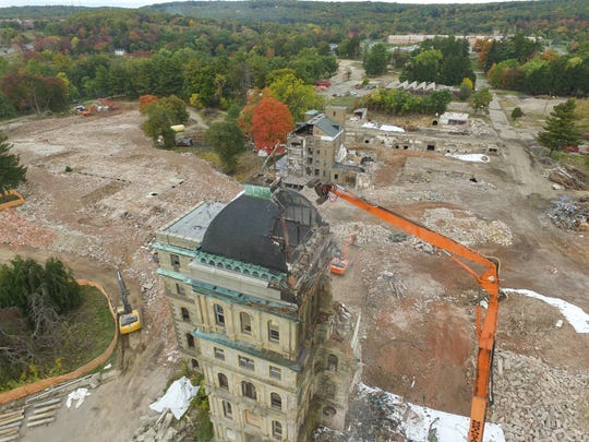 A drone-camera image of the demolition of Greystone