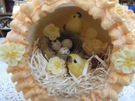 A chick and eggs inside a handmade panoramic Easter