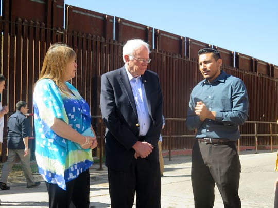 Democratic presidential candidate Bernie Sanders and his wife Jane O'Meara speak with a young immigrant named Julio Zuniga who told him about his struggles in this country after being brought here illegally by his family, after a Sanders news conference near the U.S.-Mexico international border in Nogales, Ariz., Saturday, March 19, 2016. He focused on immigration and said he would fight for immigration reform. (AP Photo/Astrid Galvan)