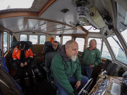 Pilot's Bill McGregor, of St. Catherines, Ontario and Scott Bruley, of Port Dover, Ontario get ready to board the freighter, Angesborg, in Lake Huron. Doug Ireland, of Port Huron, and Wayne Jurs, of Port Huron, crew the pilot boat, Huron Belle, Wednesday, April 6, 2016 for the trip into Lake Huron to board the ship.