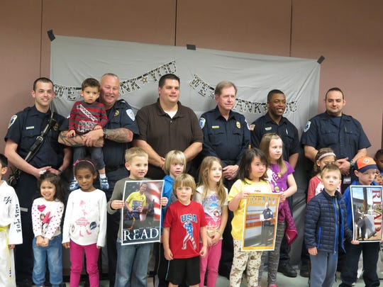 Children pose with first responders for a moment of thanks.
