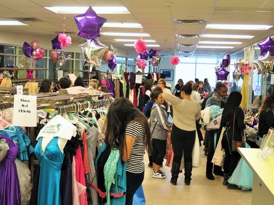 635963342533937514-Project-Prom-Princess-attendees-enjoying-searching-for-their-dream-gown.JPG