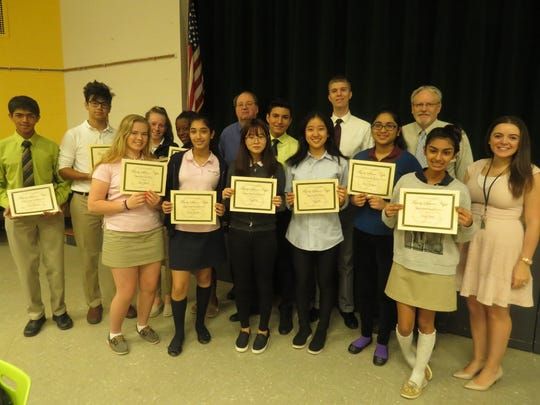 The Family Science Night award winners pose with their certificates.