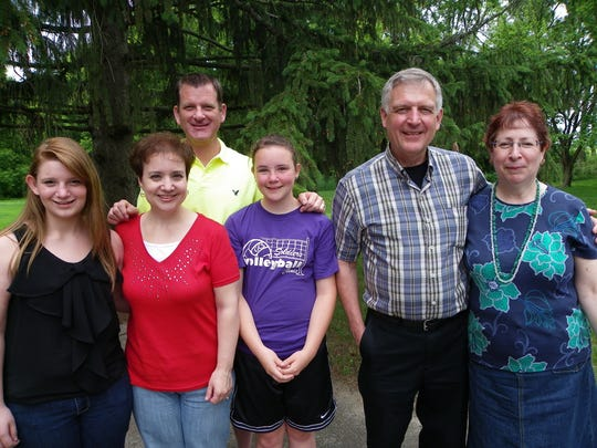 Douglas Helzerman (center right) with daughter Laura