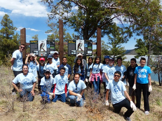 Students from Cien Aguas Escuela Internacional in Albuquerque came to Grindstone as a class project to install interpretive signs for osprey nests and clear a viewing area.