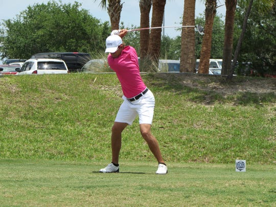 Eastern Florida's Kerry Sweeney tees off at the 10th Thursday at Duran Golf Club.