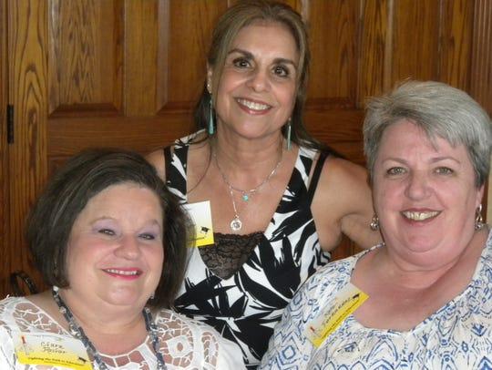 Clara Resler, from left, Dee Frezier, and Kate Ferrandez