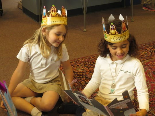 Deanna Nicholls of Dunellen and Carly Jones of Scotch Plains read their stories during the Publishing Ball.