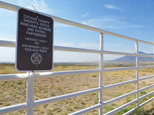 A sign from the Cochise County Sheriff's Department hangs in front of the San Jose Ranch, which shares 10 miles with the U.S.-Mexico border in southern Arizona near Naco, Ariz., on Thursday, June 9, 2016. Ranch owner John Ladd is one of about 30 border ranchers who received police radios from the Cochise County Sheriff's Department this week so that they could more easily communicate with 911 when they are in remote areas that have poor cell phone signal. The ranchers say that drug smugglers and other criminals frequently cross through their land, putting them in danger.