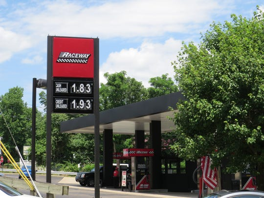 Motorists fill up for the Fourth of July weekend. Gas is at its lowest for the holiday in more than a decade.