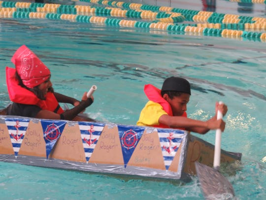 "Kori Brown of Plainfield and Krishna Patel of Piscataway navigate their boat, which won the title of ""Most Creative."""