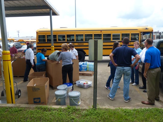 Sabine Parish school officials delivered supplies to Lafayette Parish Friday to help with flood recovery.