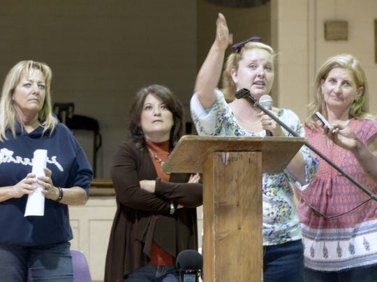 From left, Bruna Campos, Melissa Babcock, Teeatta Lippert and Shelley McAlister fielded questions from herd supporters about the future of the horses during a meeting Monday.