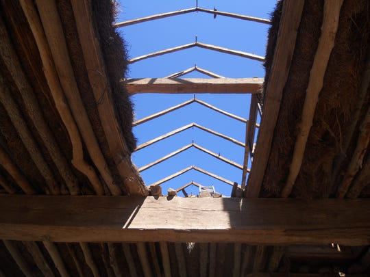 The steeply pitched gabled roof is visible through the hayloft.