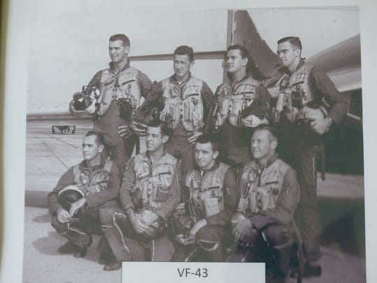 Dick Dierker, pictured on the far lower right hand corner, poses with his U.S. Navy squadron.