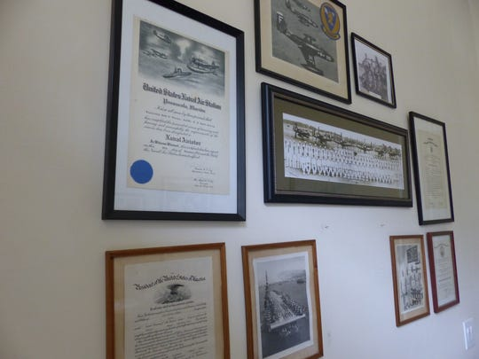 U.S. Navy mementos are displayed on the wall of the