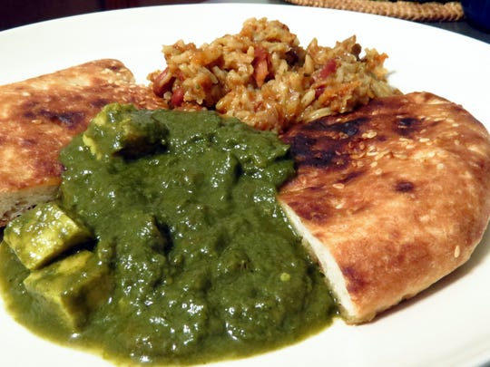 Interested in trying Indian food? International Bazaar carries dozens of 2-serving shelf-stable entrees and frozen breads to make experimenting with new tastes easy and inexpensive. Pictured are kulcha bread with palak paneer (cheese in spinach gravy) and kidney bean rice.