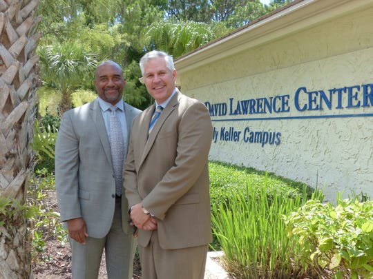 CEO Scott Burgess, left, and director of constituent relations, Darcy Taylor, right, pose in front of the David Lawrence Center, which depends on grants and donations from the community to provide for the more than 40,000 patients every year.