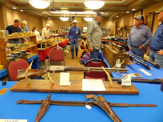 One of the displays at the annual gun and collectible show features a double threat of gun and knife.